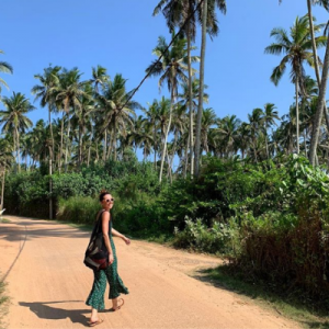 woman walking on palm tree trail