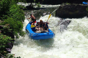 family dealing with white water rapids